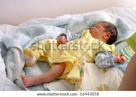Sweet dream after childbirth, newborn baby in hospital.