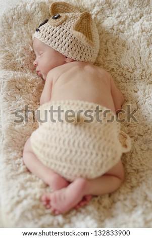 sweet  dreaming newborn wearing dog costume