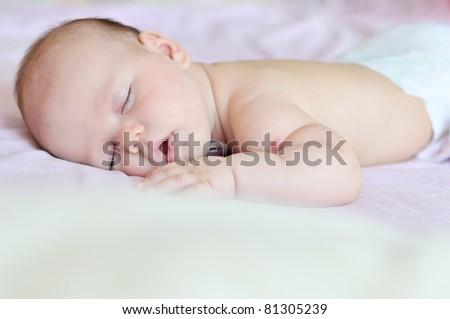 sweet dreams of baby girl in soft focus