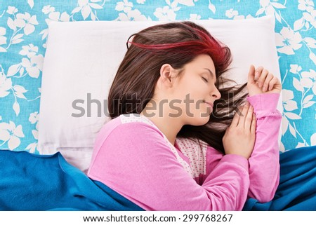 Sweet dreams. Young girl sleeping in her bed.