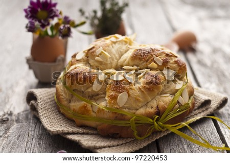 Sweet Easter bread with egg decoration and flowers
