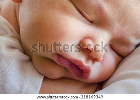 sweet face of a 3 day old infant baby boy, sound asleep. the face of innocence, peace, and beauty