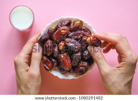 Sweet food for Ramadan. Milk and dates fruit.