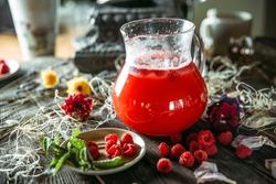 Sweet fresh berry lemonade beverage in a jar with rapsberries, horizontal
