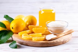 Sweet fruit lemon marmalade. Dessert marmalade in the form of lemon with gelling agents on a wooden board