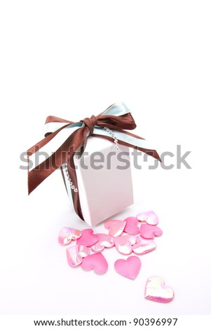 sweet gift, a white gift box with blue and brown ribbon with pink heart shape decorate.
