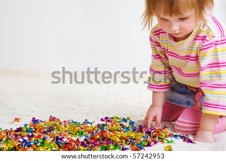 Sweet girl choosing candy