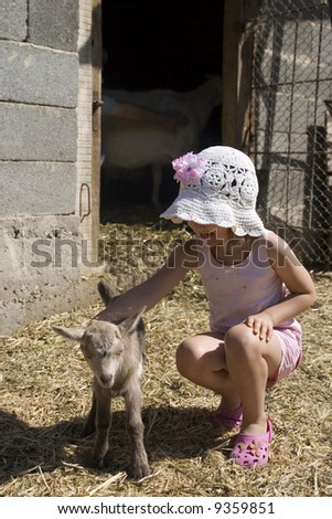 Sweet girl in the fram with baby goat