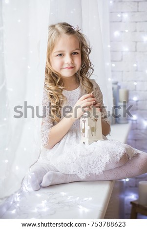Stock Photo Sweet girl surrounded by Christmas lights