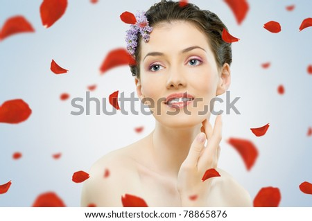 sweet girl with rose petals