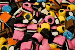 Sweet gummies, licorice gums, candies for kids and grown-ups .