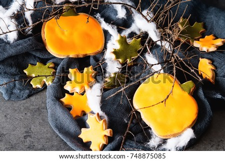 Sweet Halloween. Cookies in the form of ghosts, leaves and pumpkins. Dark background. Space for text