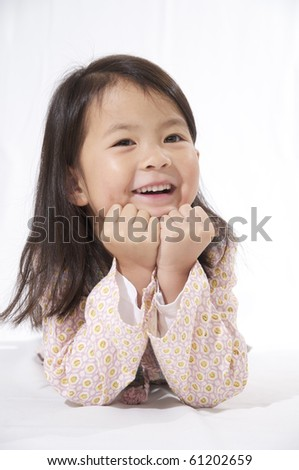 sweet happy  little asian girl on a white background