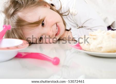 sweet happy little girl eating