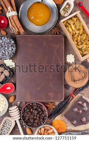 Sweet holiday recipes. Cover of the book to write prescriptions surrounded ingredients for a sweet holiday baking