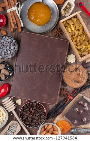 Sweet holiday recipes. Cover of the book to write prescriptions surrounded ingredients for a sweet holiday baking.