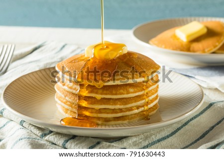 Photo of  Sweet Homemade Stack of Pancakes with Butter and Syrup for Breakfast