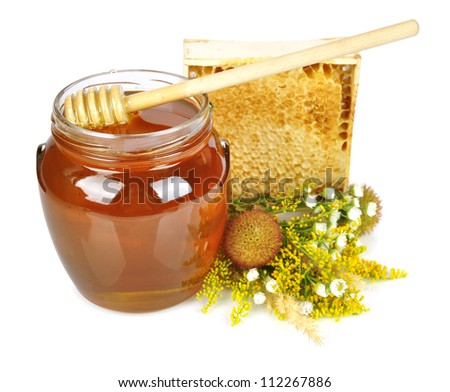 sweet honey in glass jar with wooden honey dripper, fresh honey in comb  and bouquet of wild flowers