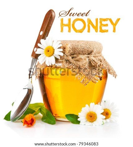 sweet honey in glass jars with spoon and flowers isolated on white background