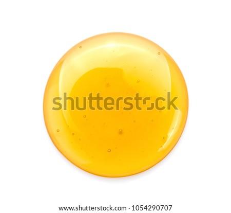 Sweet honey isolated on white background.