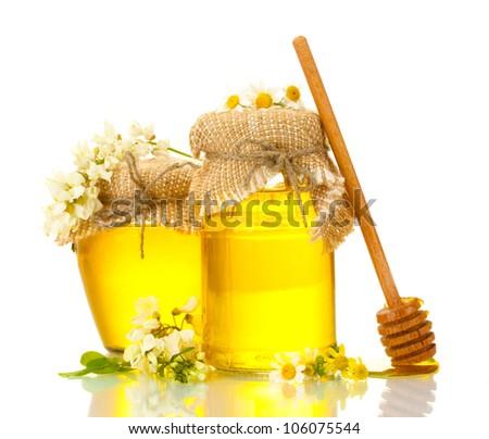 Sweet honey jars and acacia flowers isolated on white