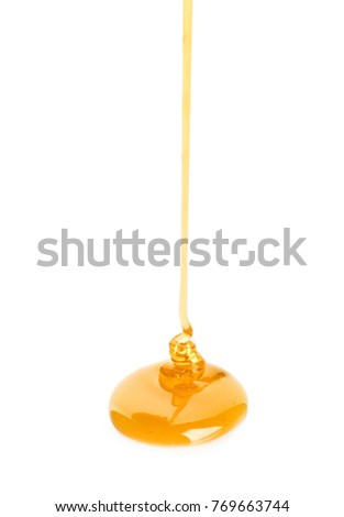 Sweet honey pouring on white background #769663744