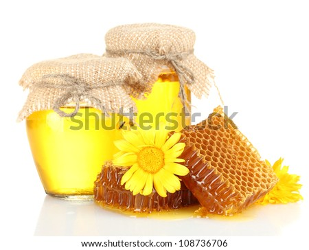 sweet honeycombs, jars with honey and flowers, isolated on white
