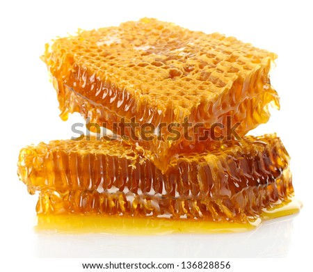 sweet honeycombs with honey, isolated on white