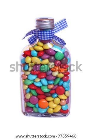 sweet jar full of smarties on a white background