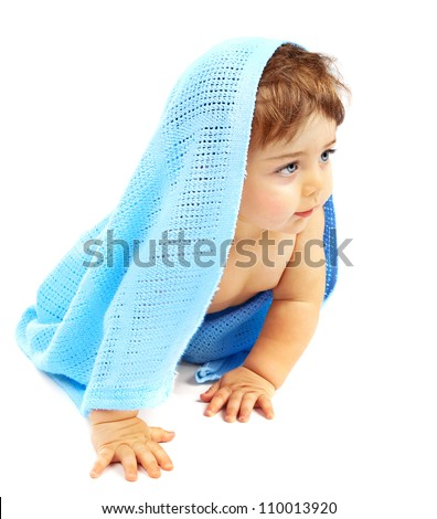 Sweet little baby boy covered blue towel, adorable child isolated on white background, cute small kid sitting indoor, healthy lifestyle, happy childhood concept