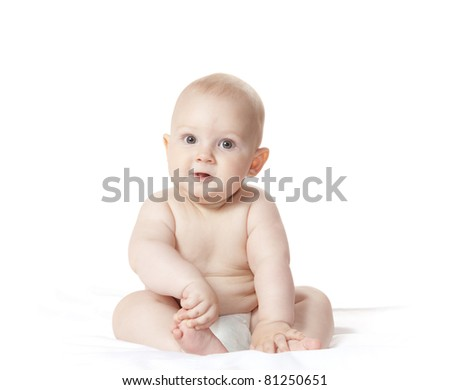 Sweet little child playing with his foot and looking into the camera