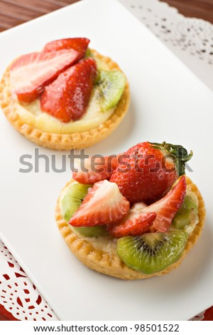 Sweet little fruit tart with kiwi and strawberries