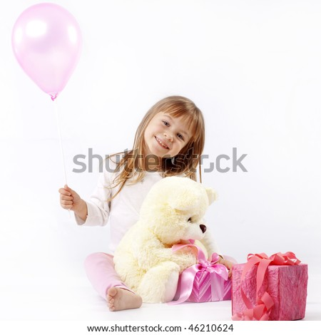 Sweet little girl is giving presents in her birthday