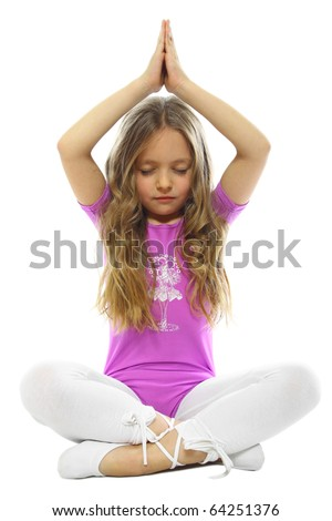 sweet little girl meditating isolated on white