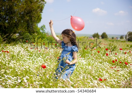 Sweet little girl on the beauty field with wild flowers