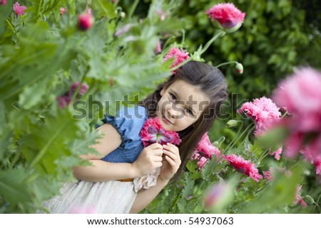 Sweet little girl on the field with poppies