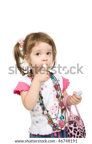 Sweet little girl using makeup