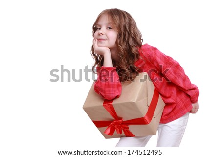 Sweet little girl with present box as a gift for Christmas and birthday