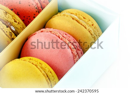 Sweet Macaroons in a Box Isolated on White Background..