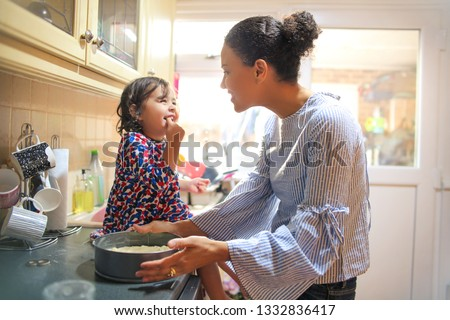 Sweet mother and daughter cooking together #1332836417