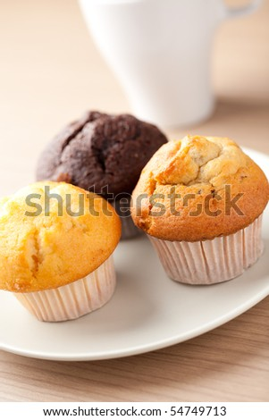 sweet muffins on wooden table