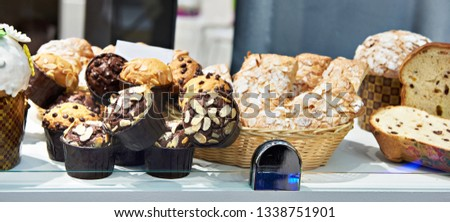 Sweet pastries on the counter of a pastry shop #1338751901