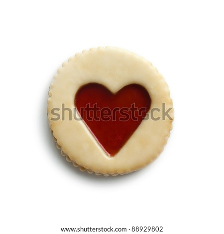 Sweet pastry with jam heart on white