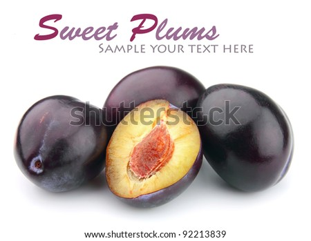 Sweet plums close up on white - stock photo