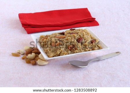 Sweet pongal, a south Indian, vegetarian, traditional and popular cuisine, which has barnyard millet as the main ingredient, is typically made on the Indian festival day of Sankranti, on a plate.