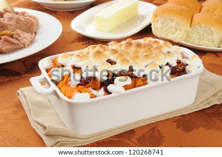 Sweet potato casserole with turkey and dinner rolls