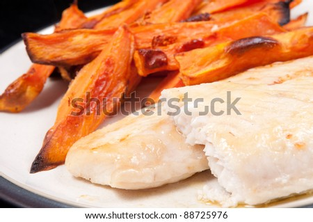 sweet potato french fries and grilled basa fish fillets with lemon