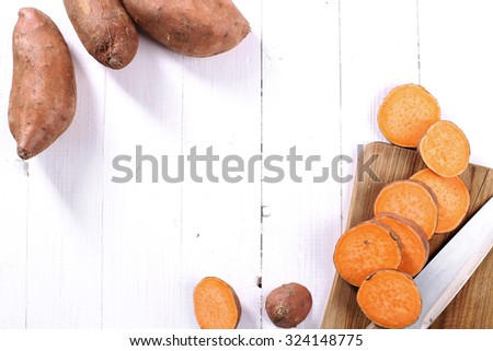 Sweet potato on the wooden table #324148775