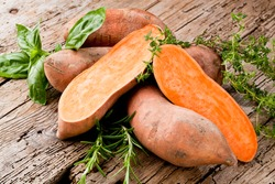 Sweet potato on Wooden background