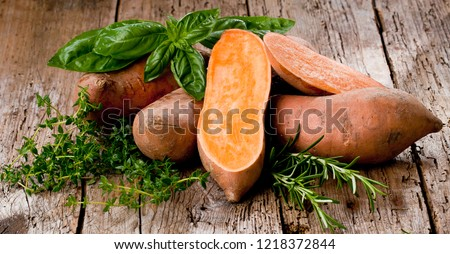 Sweet potato on Wooden background  #1218372844